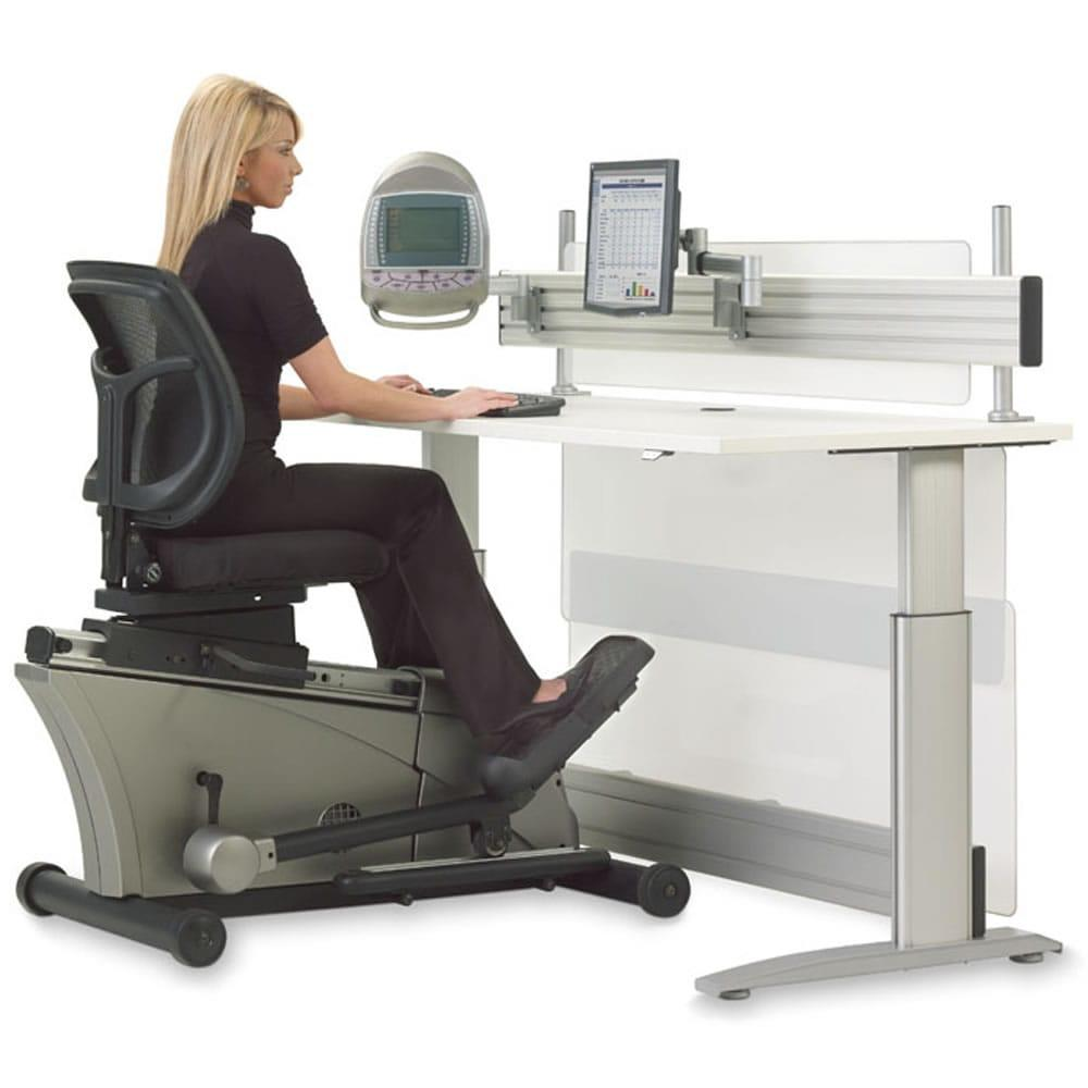 A woman sitting in a Hammacher Schlemmer Elliptical Machine Office Desk