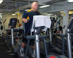 Male Doing Exercise in Elliptical Machine