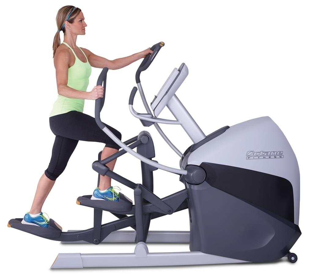 A woman using Octane Fitness XT One Elliptical