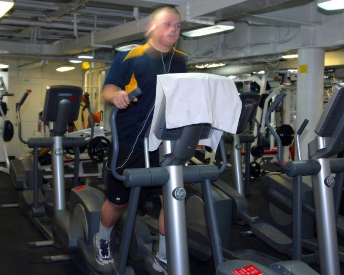 Male on Elliptical Training machine