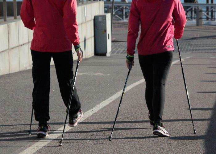 Two people walking with walking sticks