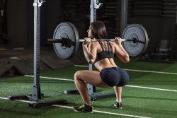 Female deadlifting